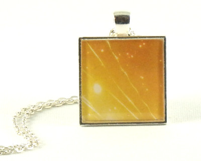 Celebrate! Handmade one-of-a-kind resin pendant