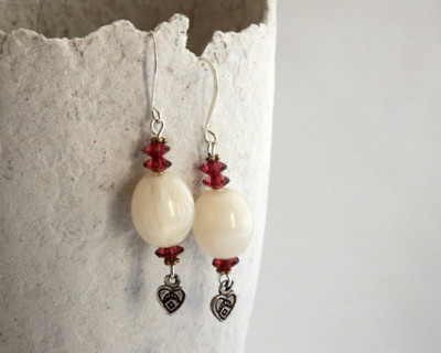 White dangle earrings with red violet faceted beads and Bali style heart charms