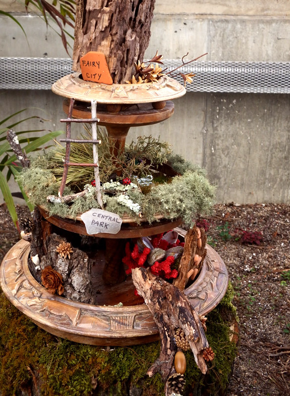 Fairy city with 3-tiered planter with twig ladder