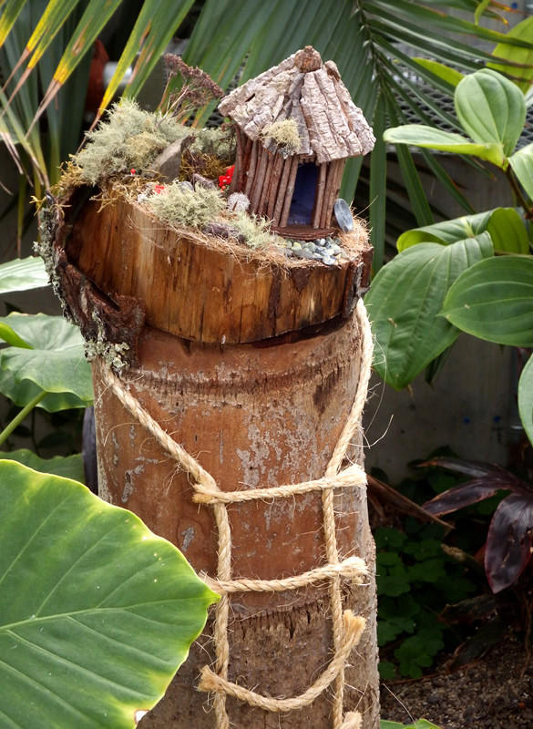 Fairy home made of a log and twigs, moss and bark