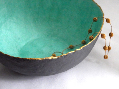 Large bowl with soft blue-green tissue paper lining, gray chalk paint exterior and gold metallic rim, from papier maché clay
